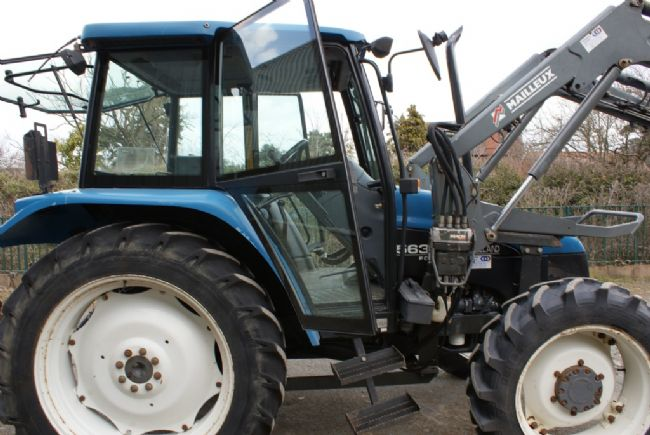 Dsc likewise Dsc moreover F D C A E F Bd Ba Da B as well Dsc furthermore  on new holland 75hp 4x4 tractors